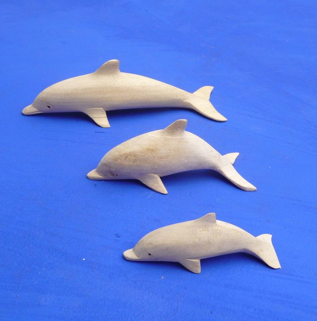 kunsthandwerk von bali delfine wale und fische aus holz. Black Bedroom Furniture Sets. Home Design Ideas